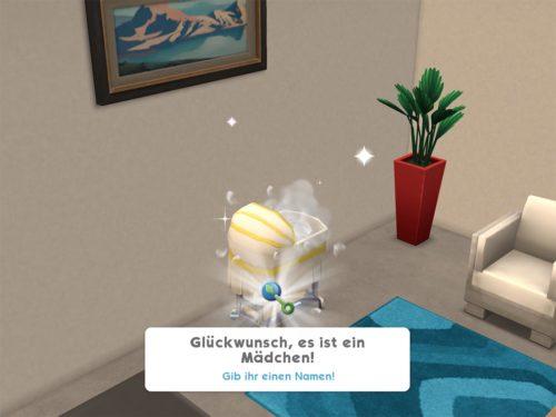 Das Baby ist nun in der Wiege bei Sims Mobile - Du kannst diesem nun einen Namen geben